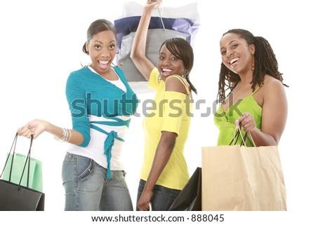 Three girl friends going shopping - stock photo