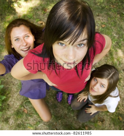 Three girlfriends at the park. - stock photo