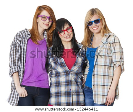 Three girlfriends at white background isolated - stock photo