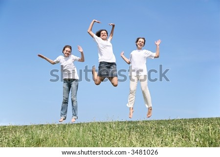 Three girlfriends in white T-shorts jump together