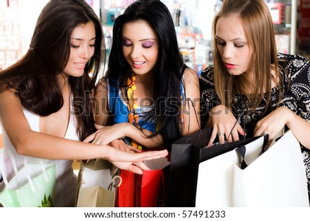 Three girls are  shopping - stock photo