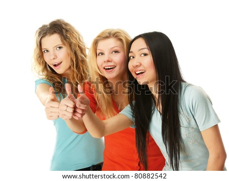 Three girls are showing a sign okay  on white background - stock photo