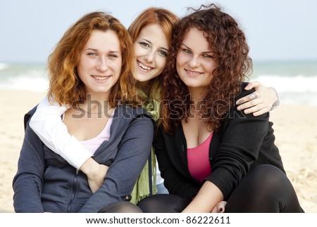 Three girls at outdoor near beach. - stock photo