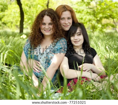 Three girls at park. - stock photo