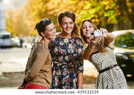 three Girls Friends making selfie - stock photo