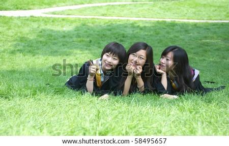 Three girls in campus - stock photo