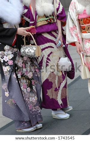 three girls in Japanese kimono - stock photo