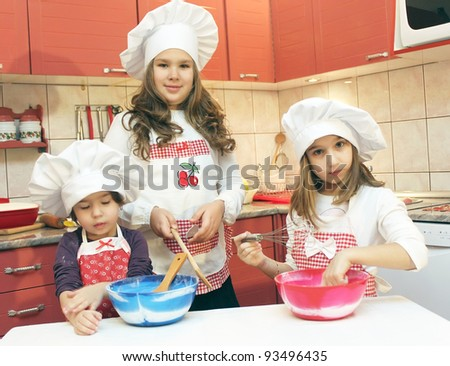Three girls in the kitchen - stock photo