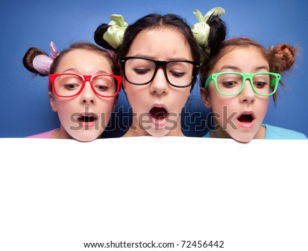 Three girls looking down