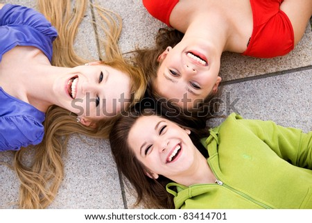 Three girls lying in circle - stock photo