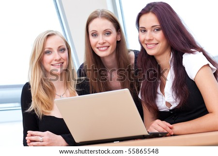 three girls nattering and having fun at the notebook