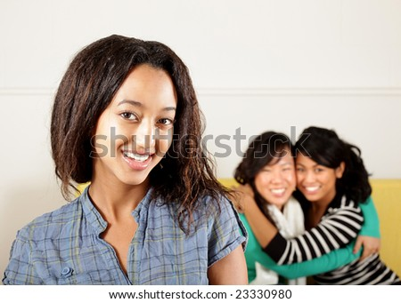 Three girls, one upfront with copy space - stock photo