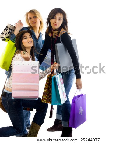 Three girls out shopping. Isolated on a white background
