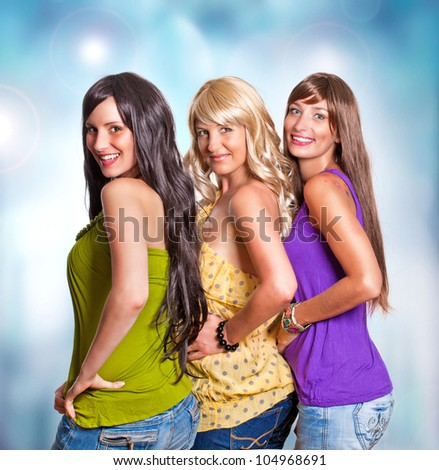three girls with different haircolor laughing together - stock photo