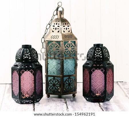 Three glass and metal lanterns - stock photo