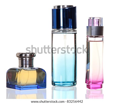 Three glass bottles of female perfume isolated on a white background - stock photo