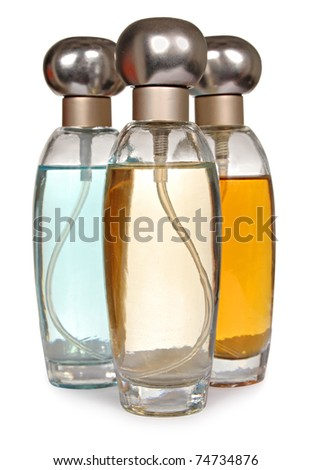 Three glass bottles of perfume isolated on a white background - stock photo