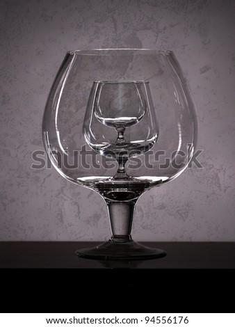 three glass for cognac over grey background - stock photo
