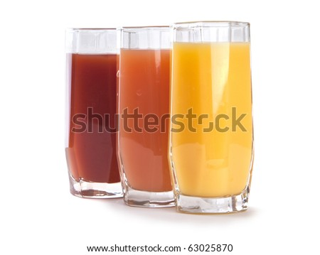 Three glass glasses of different juice, multi-colored, fresh