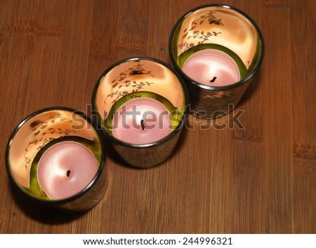 Three glass lanterns on the table - stock photo