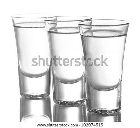 Three glass of vodka isolated on white