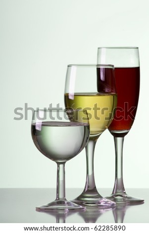 three glass of wine on a green background