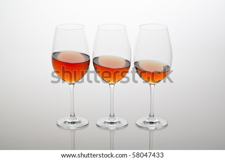 Three glass of wine, ordered reduce