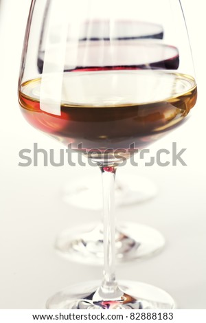 Three glass of wine (white, red and rose) over white - stock photo