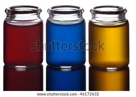 Three glasses filled with colorful liquid isolated on white - stock photo