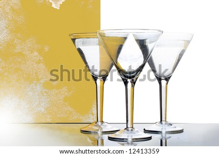 three glasses for martini with yellow reflection