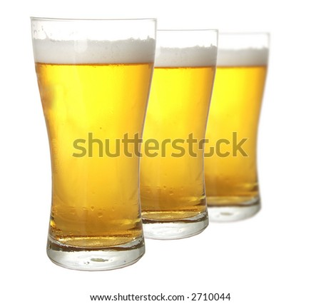 Three glasses of beer against white background