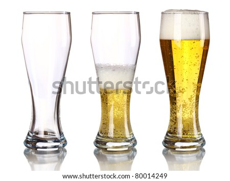 Three glasses of beer with froth