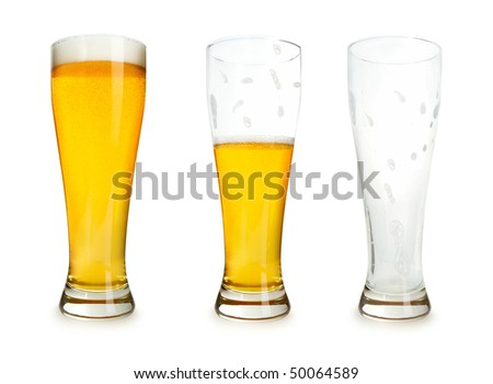 Three glasses of beer with one full, one half gone, and one empty on a white background. - stock photo