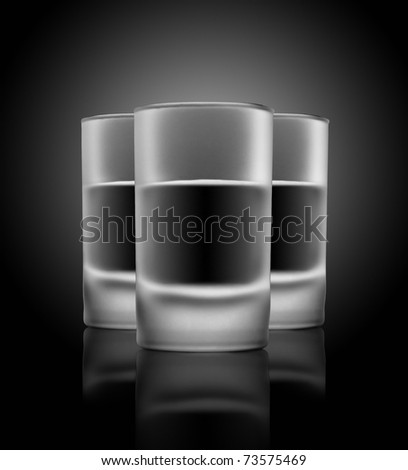 Three glasses of beverage on a glass table