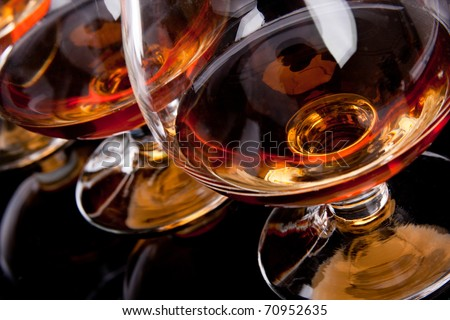 Three glasses of cognac in a row - stock photo