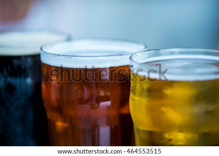 Three Glasses of Different Alcohol Beer Lager and Stout