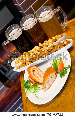 three glasses of different beer with snack - stock photo