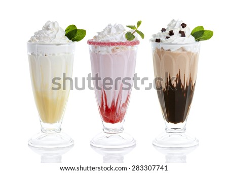 three glasses of milkshakes, bananashake, chocolateshake and fruiteshake cocktails  - stock photo