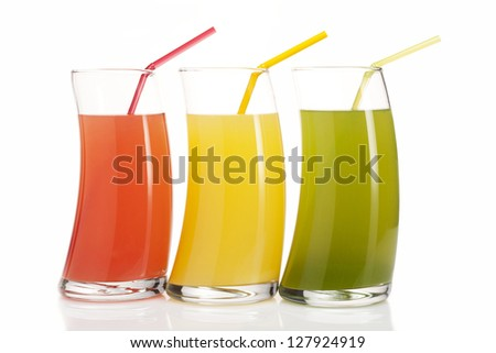 three glasses of red, green and yellow juice