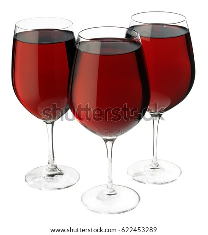 THREE GLASSES OF RED WINE ON WHITE