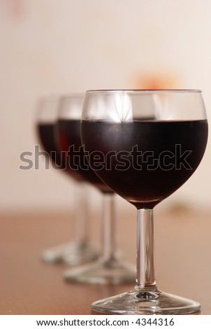 Three glasses of red wine, shallow DOF