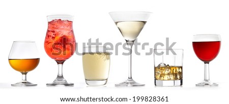 three glasses of various drinks on a white background - stock photo
