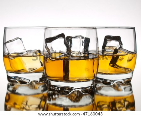 Three glasses of whiskey in a row - stock photo