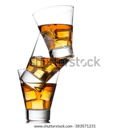 Three glasses of whiskey on the rocks - stock photo