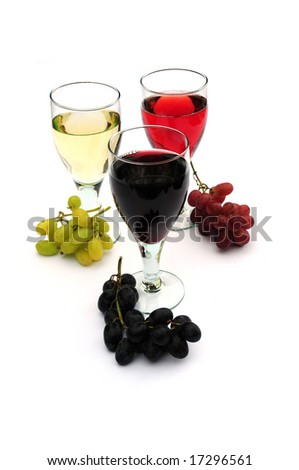Three glasses of wine and grapes
