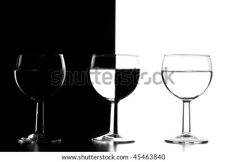 three glasses of wine on a black and white background