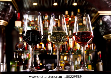 Three glasses of wine on the counter - stock photo
