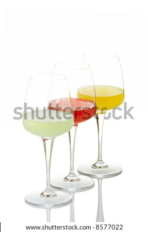 Three glasses with beverages, reflected on white background