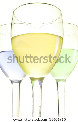 three glasses with blue green and yellow drinks