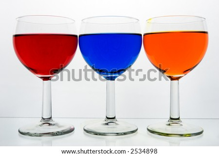 Three glasses with color drinks, isolated on white